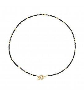 Zwarte met goudkleurige halsketting met kralen, er is ook bijpassende armband bij.